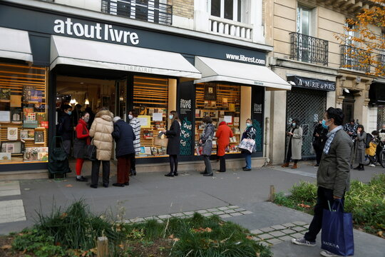 People queue at a 'click and collect' service in Paris