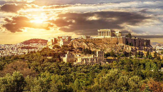 Acropolis of Athens at sunset, Greece. Sunny panorama of Greek ruins.
