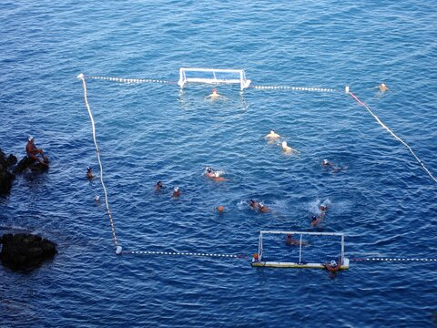 High Angle View Of Men Playing Water Polo In Sea