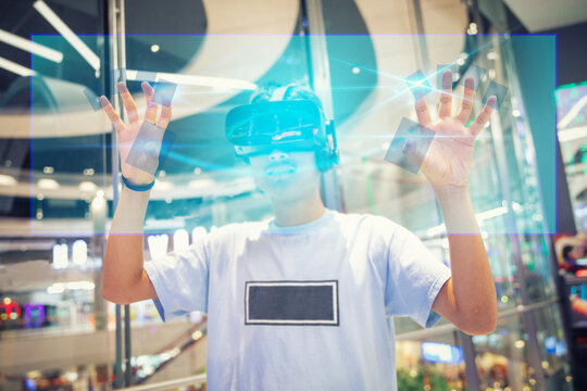 Digital Composite Image Of Man Wearing Virtual Reality Eyeglasses While Standing In Shopping Mall