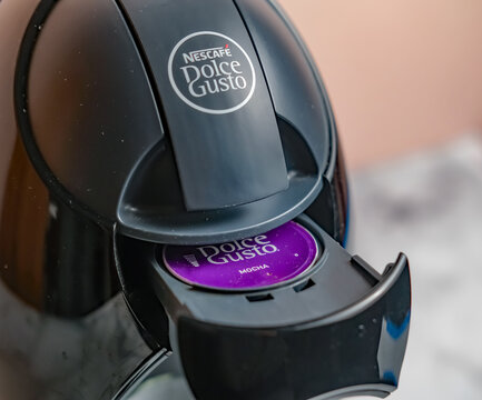 Norwich, Norfolk, UK – November 20 2020. An illustrative photo of a Dolce Gusto mocha capsule in a Dolce Gusto coffee machine