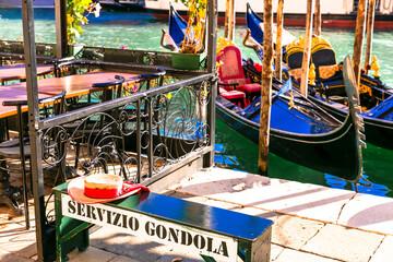 Romantic gondola trip in Venice. Gondola service and boat station near Rialto bridge. Italy nov 2020