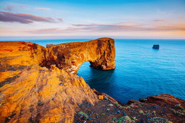 Wall Mural - Fantastic large arch of lava in the Atlantic Ocean. Location place cape Dyrholaey, Iceland, Europe.