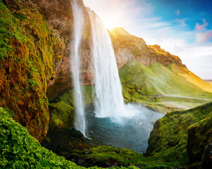 Wall Mural - Great view of powerful Seljalandsfoss waterfall in the sunny day. Location place Iceland, Europe.