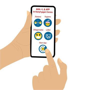 Hand hält Handy mit Aha + L & App. Symbole mit Emoticons.