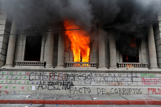 An office of the Congress building is seen after demonstrators set it on fire during a protest demanding the resignation of President Alejandro Giammattei, in Guatemala City