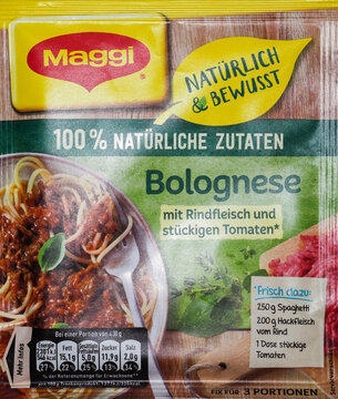 German Maggi instant products on a white background owned by Nestle. Maggi is an international brand of soups, stocks, bouillon cubes, ketchup, sauces, seasonings and instant noodles.