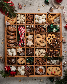 Christmas Cookies box with a lot of cookies, candies and christmas balls on white background