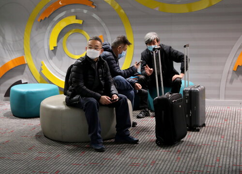 Travellers at Beijing Capital International Airport amidst the global outbreak of the coronavirus disease (COVID-19)