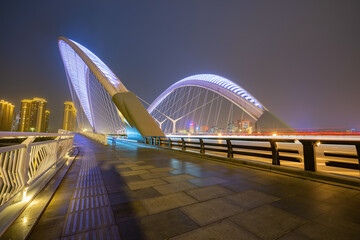Fotomurales - Car light and shadow tracks on bridges and highways at night, Taiyuan, Shanxi Province, China