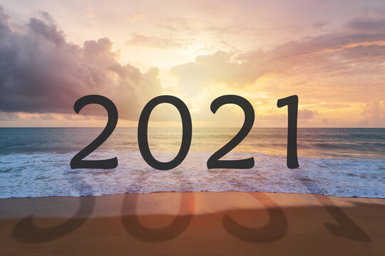 Number 2021 on beach. New year concept