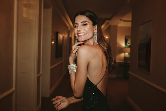Attractive woman in elegant evening gown