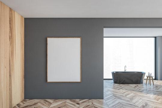 Mockup canvas frame on grey wall in bathroom with grey bathtub and window