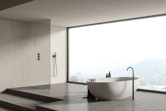 Concrete bathroom corner with tub and shower