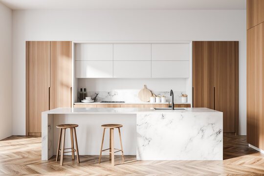 White and wooden kitchen with bar