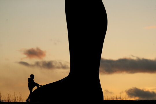 People watch sunset at the Angel of The North in Gateshead