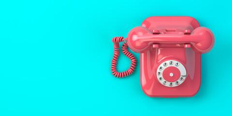 Fototapeta Pink vintage rotary telephone on mint green background.
