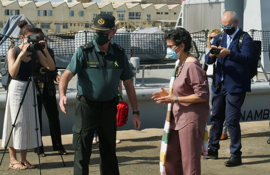 Spanish Foreign Affairs Minister Arancha Gonzalez Laya speaks to an officer of the Spanish civil guard during her visit in Dakar
