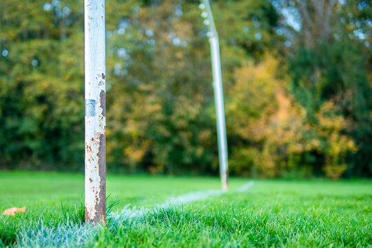 An old rusty abandoned football (soccer) goal on an english park symbolizing the death of grass roots sunday league football in the UK as a result of Covid-19 Coronavirus