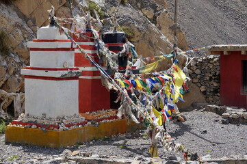Traditional Buddhist chortens stand in the Himalayan mountains in the place of worship of the gods, with garlands of flags. Upper Mustang. Nepal. Wall mural