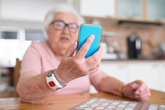 Senior woman using smart phone, Sweden