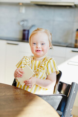 Smiling girl at table, Sweden