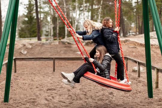 Girls on swing, Sweden