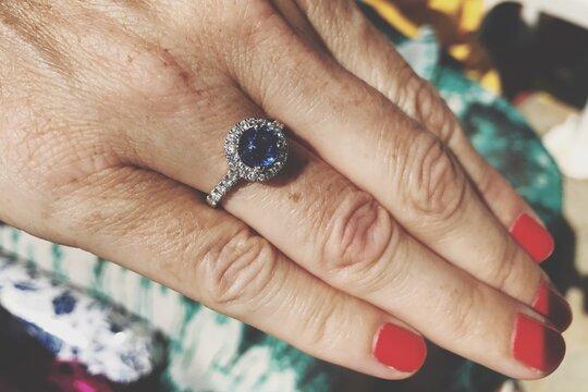 Cropped Image Of Bride Wearing Wedding Ring