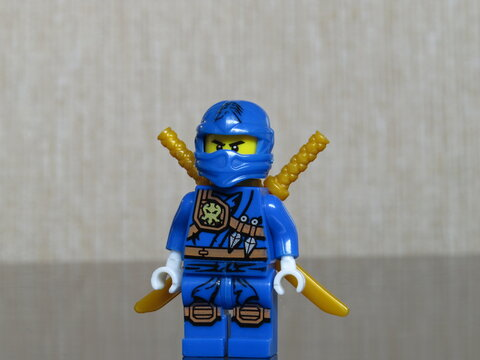 Blue Lego Ninjago with swords on its back.
