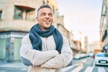 Fototapeta Young caucasian man smiling happy walking at the city.
