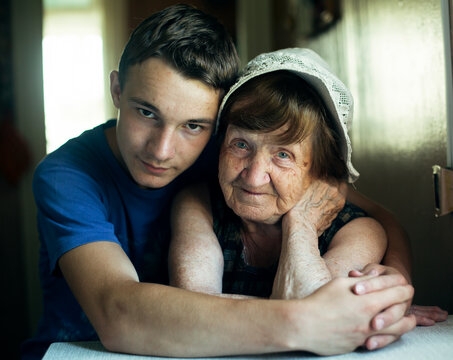 Portrait of a old woman grandmother and her grandson.