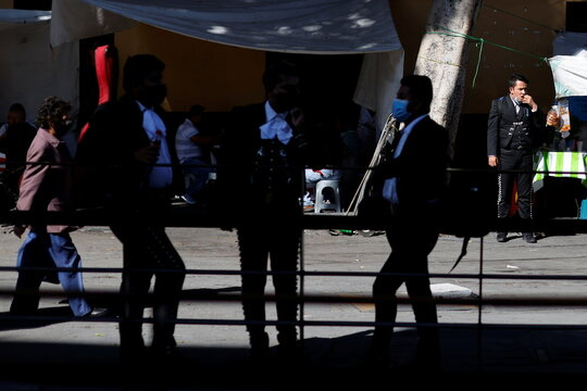 Mariachis wait for customers during the annual celebration of Saint Cecilia, the patron saint of musicians, as the coronavirus disease (COVID-19) outbreak continues, in Mexico City