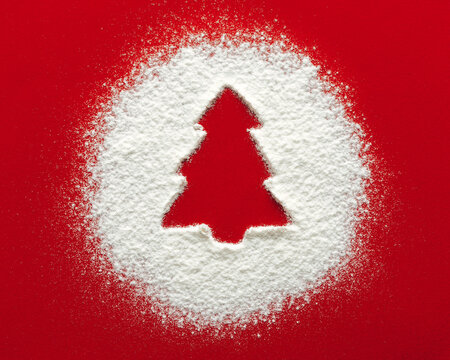Christmas tree floury snow circle shape, red paper background