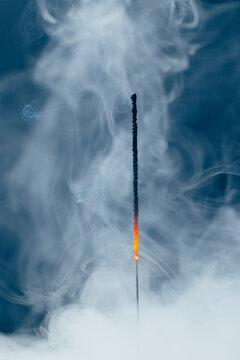 extinct sparkler in dense smoke