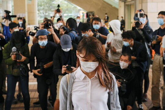 Pro-democracy activist Agnes Chow arrives at the West Kowloon Magistrates' Courts to face charges related to illegal assembly stemming from 2019, in Hong Kong