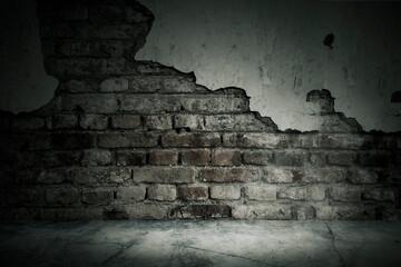 Damaged brick wall of an abandoned house