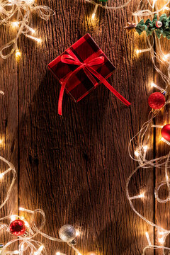 christmas and happy newyear festive background ideas gift presents boxes with light bulb decorating arrange flatlay on old rustic wooden table top