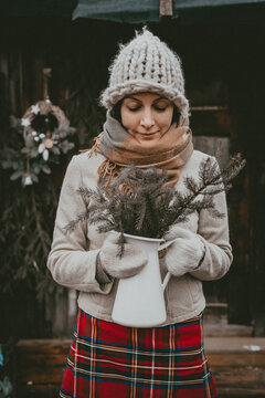 holiday decoration woman creates Christmas atmosphere open air rustic minimalistic modern from natural ecological materials Scandinavian style
