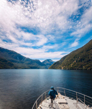 One person enjoying a cruise in the beautiful fjord at Doubtful Sound in New Zealand on a beautiful summer morning.