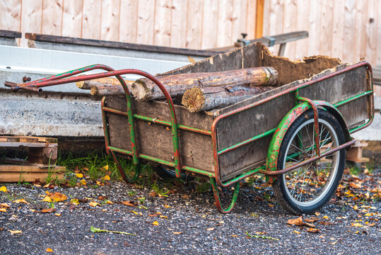 old cart used in a farm to carry wood logs