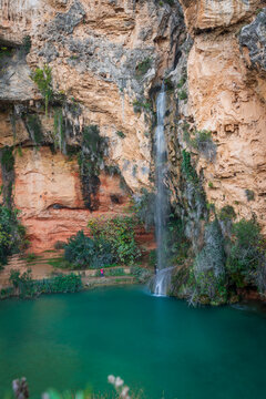 Top view of Turche cave and waterfall in Valencia, vertical composition