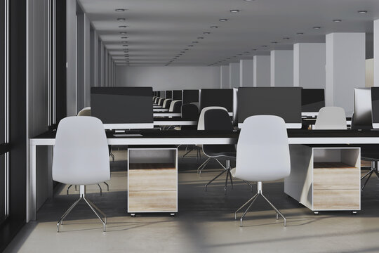 Coworking office interior with computers on table.