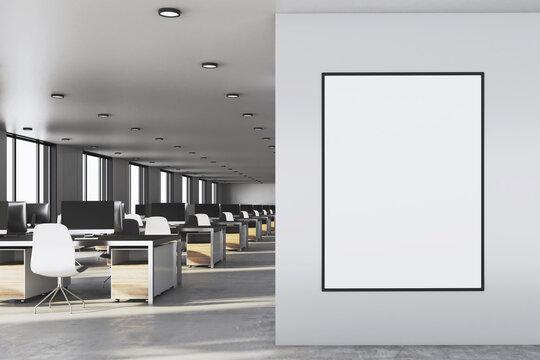 Luxury coworking office interior with blank poster on wall