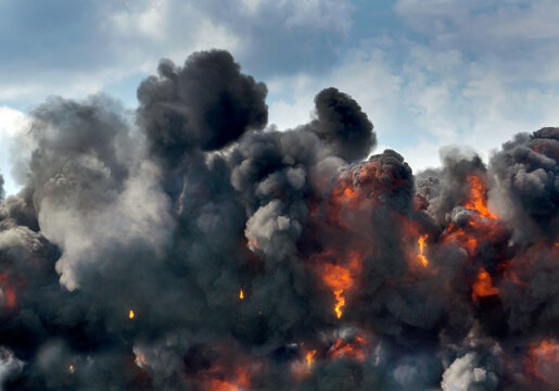 A Controlled Explosion Is Part Of A War Reenactment With Fire And Black Clouds At An Air Show