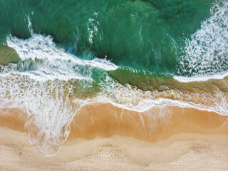 Aerial View Of Waves Rushing Towards Beach