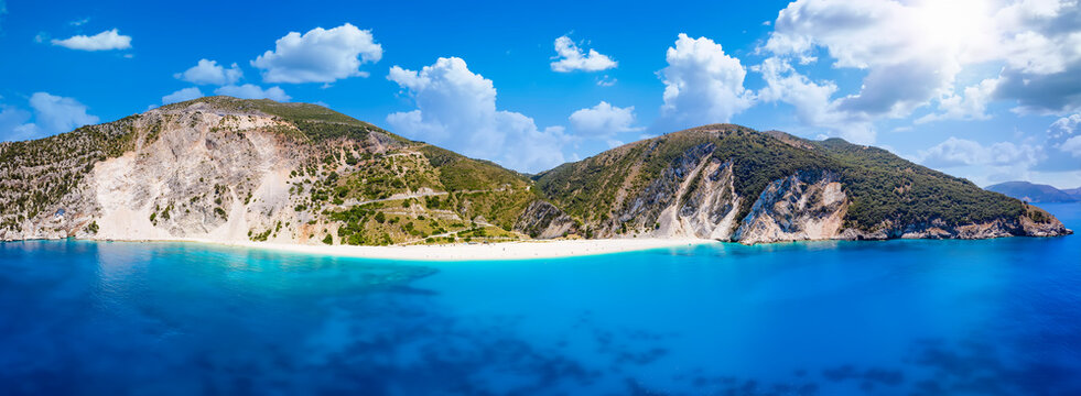 Wide panoramic aerial view to Myrtos beach and the coast of Kefalonia, Greece, with turquoise sea and sunshine during summer time