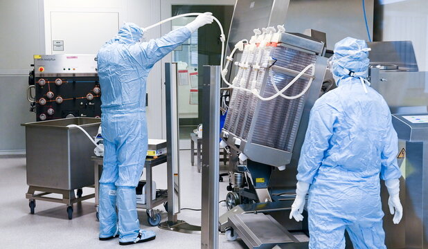 Staff works at the vaccine maker IDT Biologika production in Dessau Rosslau