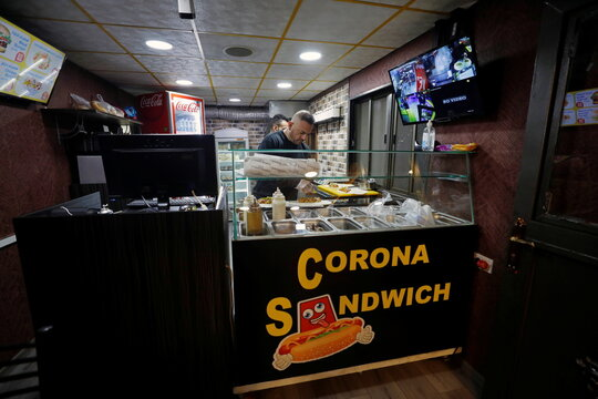 Palestinian opens corona brand restaurant to fight unemployment