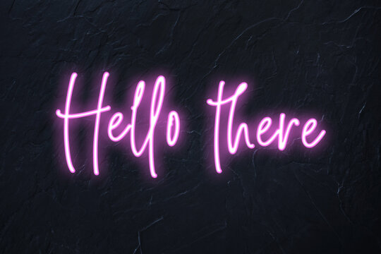 Hello there written in pink neon style on black wall background