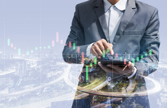 double exposure of business man using smartphone for trading stock online concept with night city background. technology digital financial with stock chart growth analysis maketing graph.